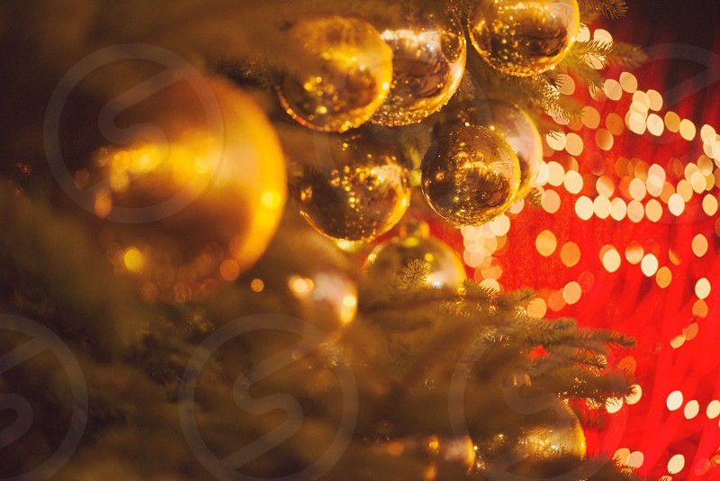 Christmas Tree Closeup with Golden Orbs and Blurred Lights photo