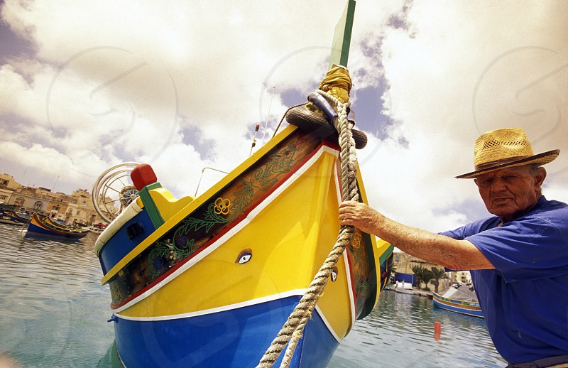 The Fishing Village of Marsaxlokk on the eastcoast of Malta in Europe. photo