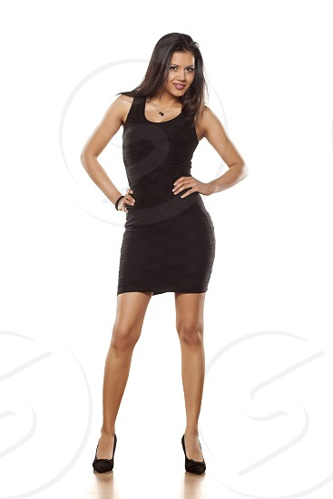 young beautiful lady posing in short black tight dress photo