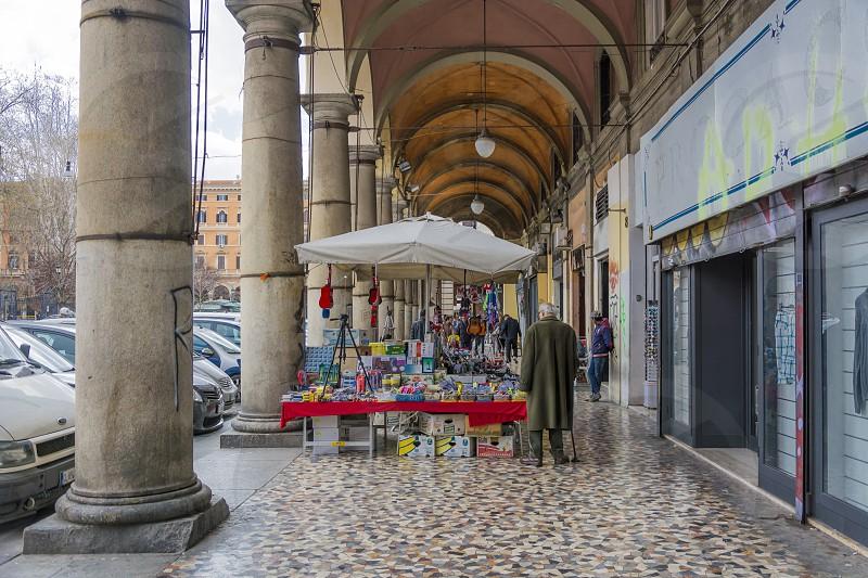 street vendors under the Piazza Vittorio arcade in Rome photo