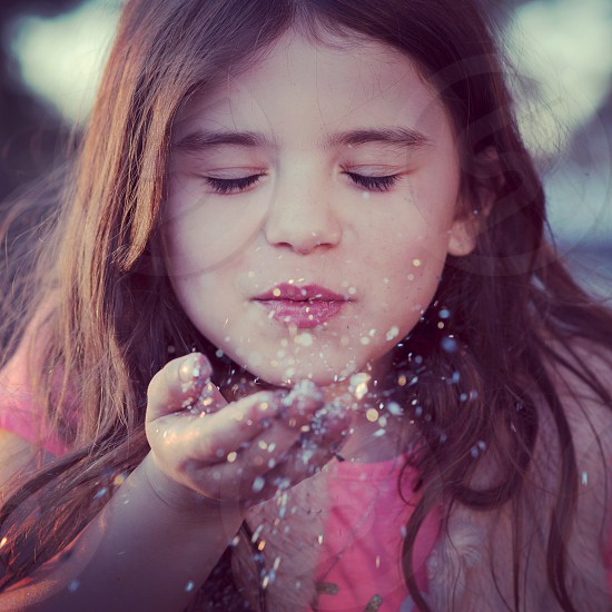 Blowing gold dust girl summer  photo