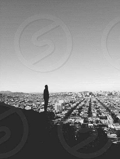 black and white man silhouette city view photography photo