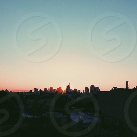 sunset over city sky line photo