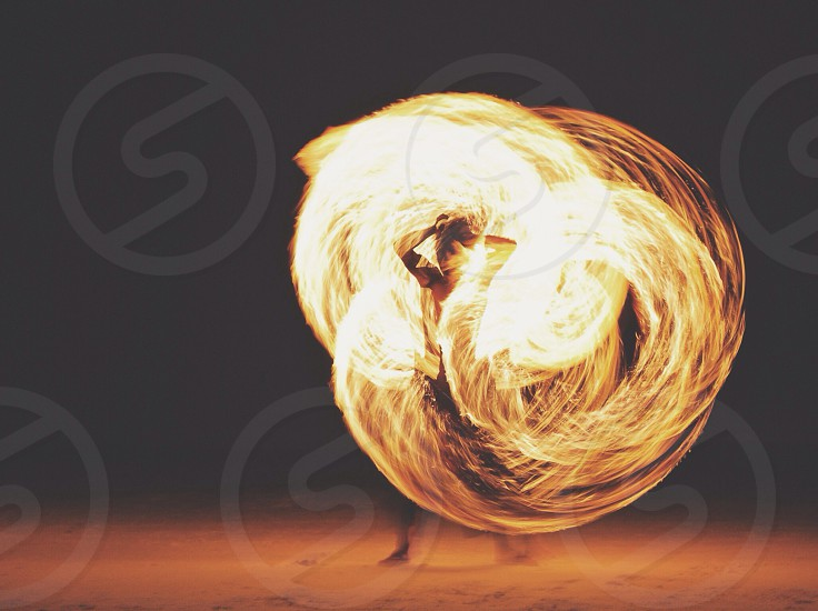 person performing fire dance photo