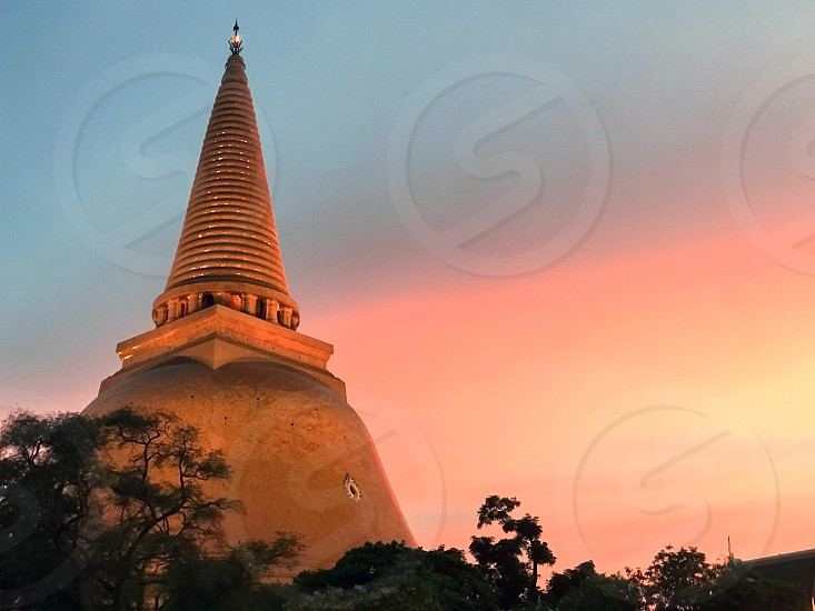Phra Pathommachedi or Phra Pathom Chedi the world's second tallest stupa located in the Wat Phra Pathommachedi Ratcha Wora Maha Wihan a Buddhist temple in the town center of Nakhon Pathom Thailand.  photo
