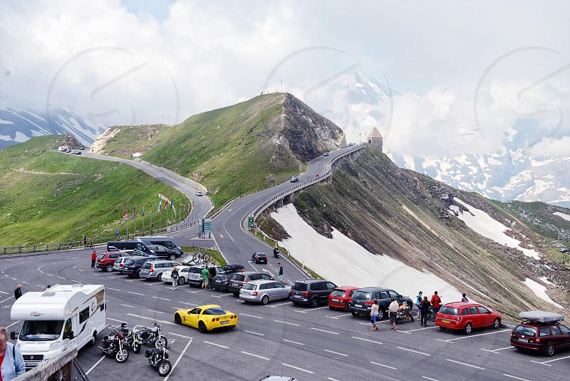 Grossglockner Salzburger Land/ Austria JULY 21 2013: People visiting the Grossglocker mountain area with snow in summer time. Alpine Grossglocker road leading through the national park photo
