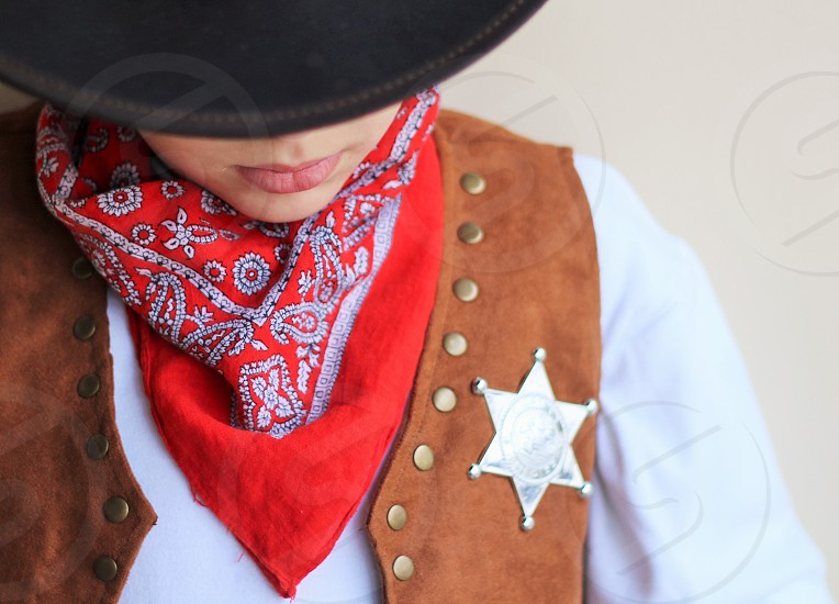 person in brown cowboy vest photo