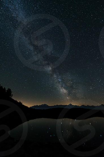 Milky way star mountain night switzerland photo