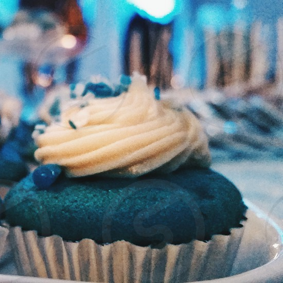 high contrast  blue cupcakes with silver foil and  white icing photo