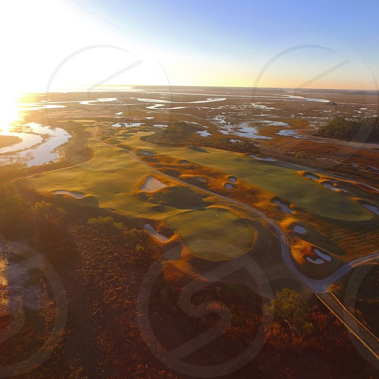 Golf Golf Course Drone low Country sunrises marsh high tide lo photo