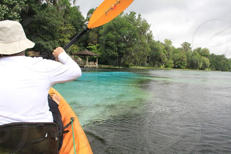 man kayaking down Rainbow River in Florida  wanderlust travel clear water freshwater river adventure horizontal photo