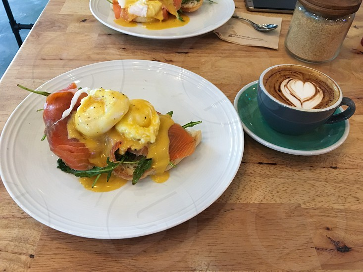 Breakfast coffee eggs eggs Benedict salmon lox food breaky breakie cappuccino latte plate mug breakfast food morning time waking up pouched eggs toast  photo