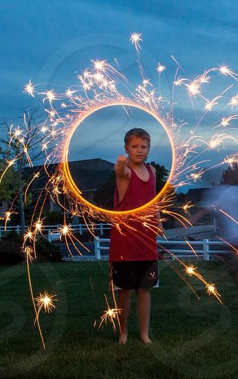 Boy w sparkler photo