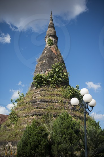 the Nam Phu or That Dam Stupa in the city of vientiane in Laos in the southeastasia. photo