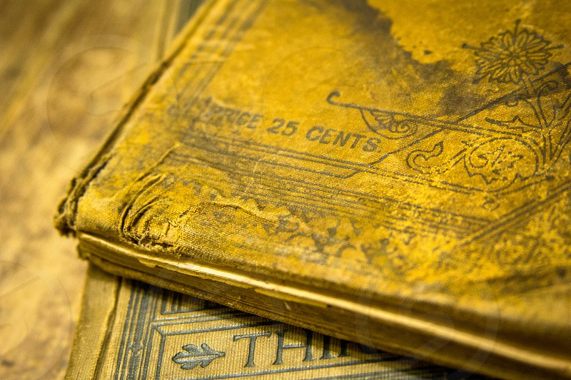 Antique books that originally sold for 25 cents photo