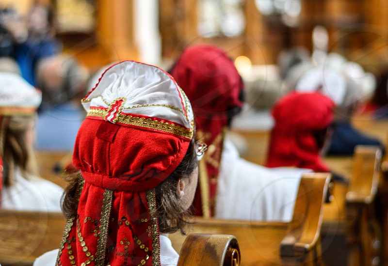 Ladies with traditional clothes in church photo