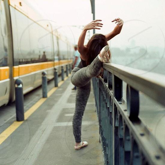woman's foot on metal railing photo