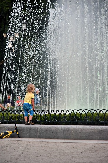 Kid looking at fountain photo