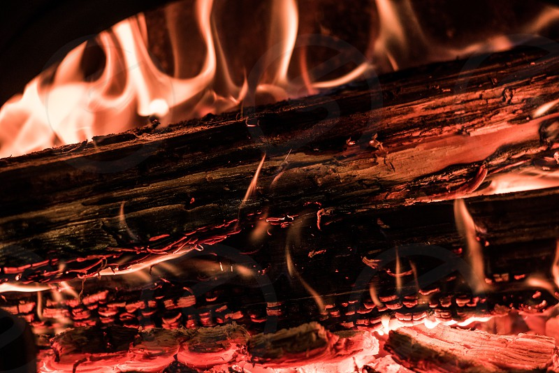 Wood in the flames of cozy fireplace photo