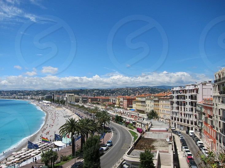 Landscape from a cliff overlooking the ocean and beachfront in Nice France. photo