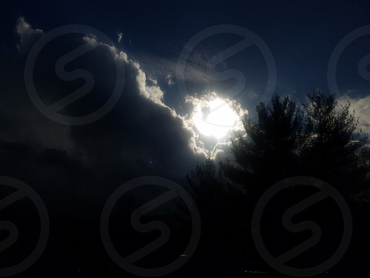 clouds rain Darkness light trees shadow sunshine silhouette Sun bright immerse daylight New Dawn photo