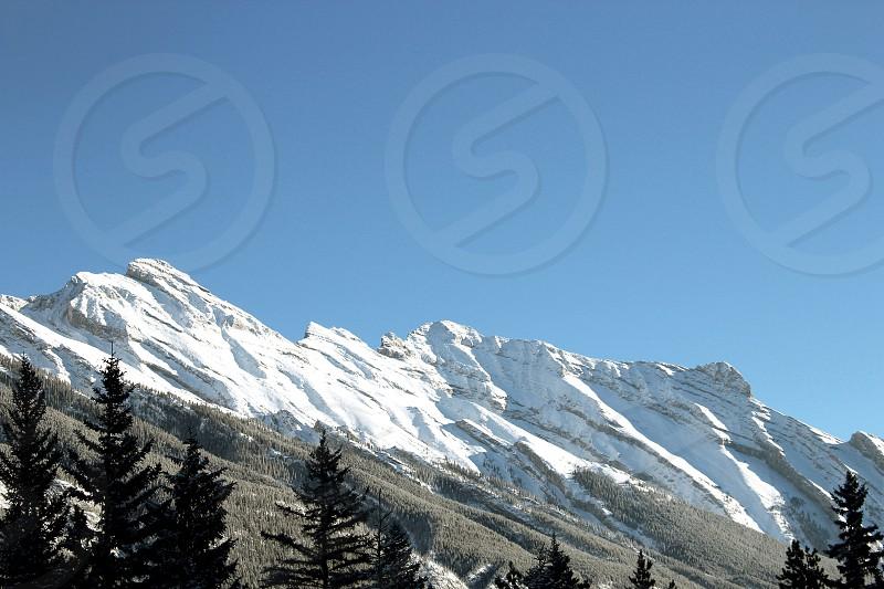 Banff mountains forest trees snow winter Alberta Canada travel explore roadtrip Sky blue photo