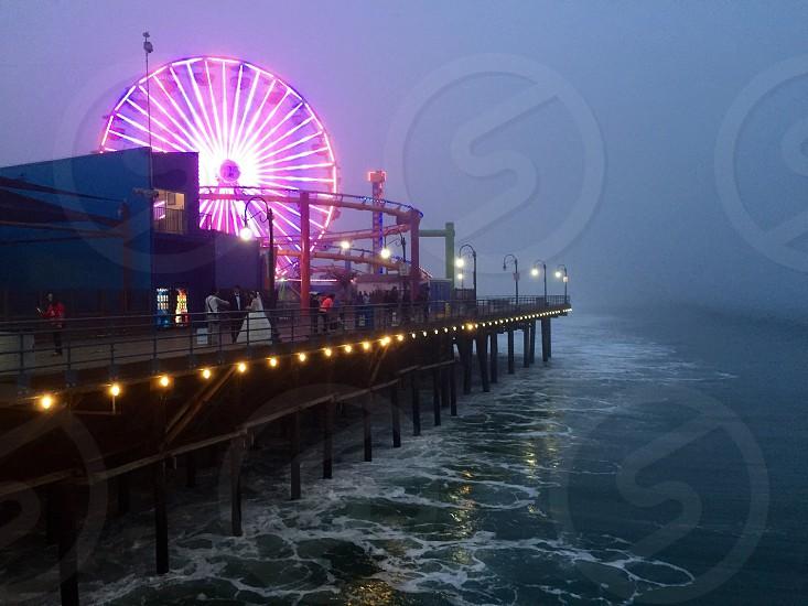 Santa Monica Santa Monica Pier California pier ocean beach Ferris wheel amusement park park jetty water fog purple neon pink lights marine layer marine layer photo