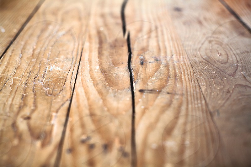 Details of an old wooden table a cracked upper plate.  photo