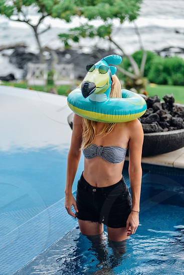 woman pool spa fun vacation summer floatie toucan funny photo