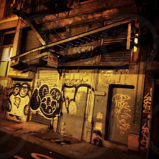 Graffiti back alley at night Chinatown New York City. photo