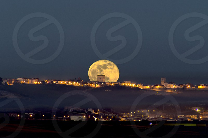Full moon rising through the castle of Portillo (Valladolid Spain) photo