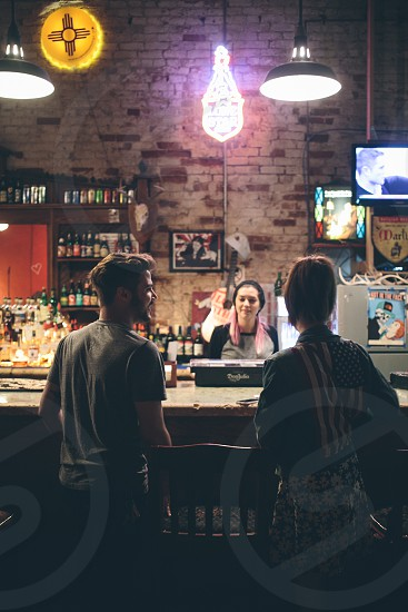 man and woman standing by the bar photo