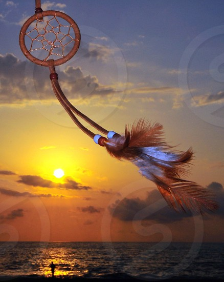 dream catcher with brown and white feathers photo