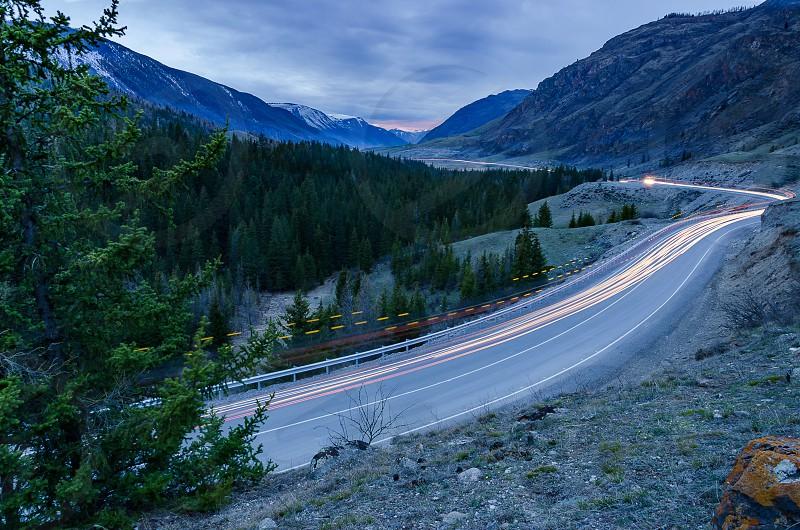 Mountain road light trails sunset dusk landscape photo