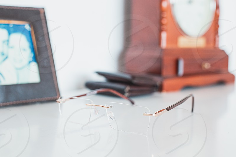 Man glasses with portrait wallet and clock photo