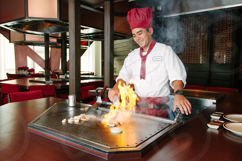 chef cooking on flat grill photo