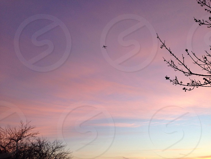 plane in sky under white clouds photo
