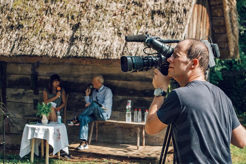 Cameraman filming an interview. photo