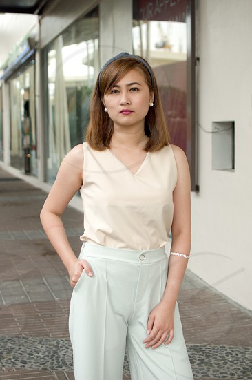 A portrait of a woman wearing a cream top photo