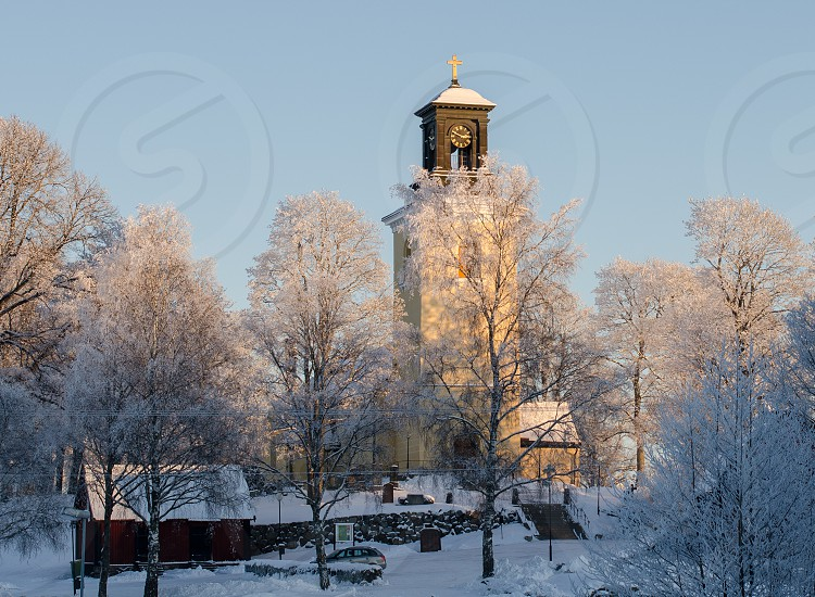 snow covered brown clock tower photo