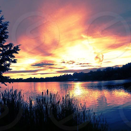Sunset beautiful summer fire sky lake photo