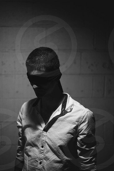 Moody blindfold black and white photo