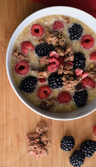 Smoothie bow yogurt fruit berries raspberries blueberries blackberries granola healthy eating lifestyle  photo