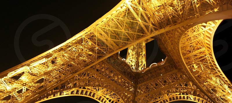 Perfectly symmetrical orange metal tower structure. Steel Paris France Eiffel night. photo
