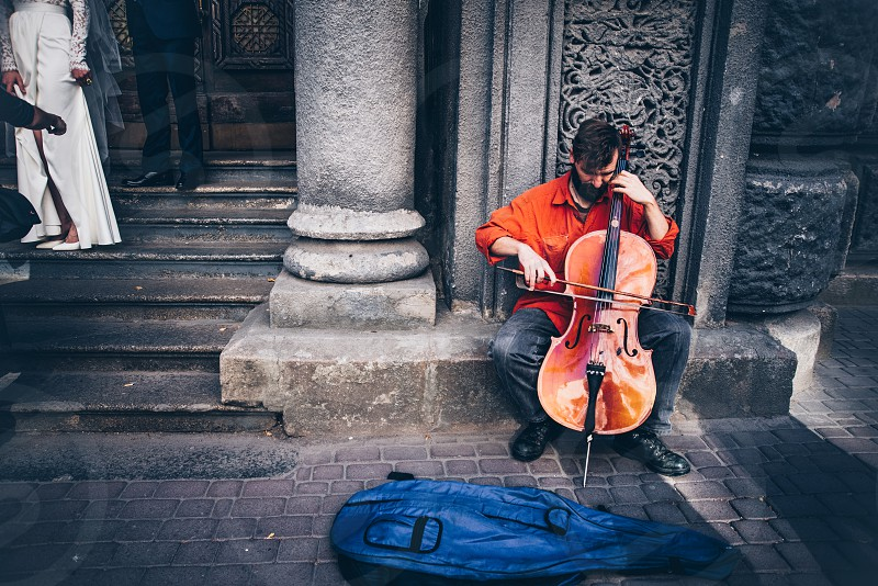 A man playing cello in Kyiv streets. photo