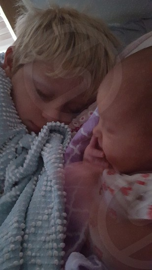 A boy and his baby sister photo