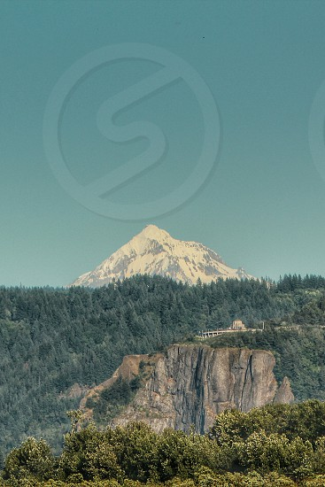 The Vista house on the scenic Columbia river gorge hwy... Mt Hood peeking over the trees photo