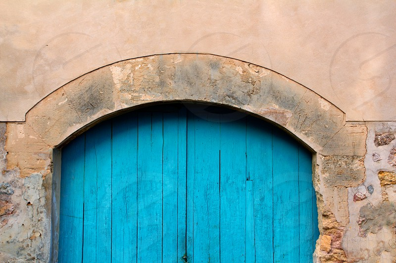 Arch wooden Mediterranean door in Valldemossa Majorca Spain photo