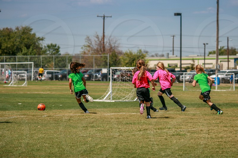 soccer game children girls young action movement ball run photo
