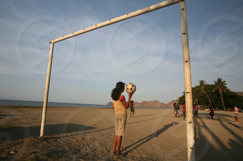 women play soccer at the coast and beach at the city of Dili in the south of East Timor in southeastasia. photo